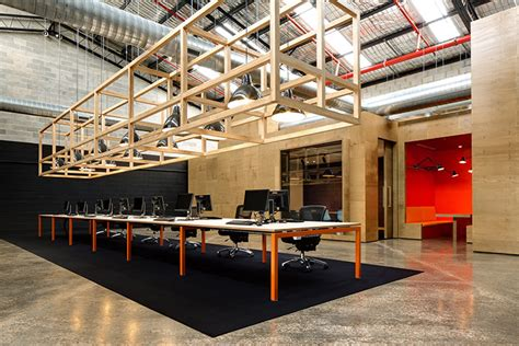 modern industrial office unit b4 by make hides a contemporary wooden office within an industrial shell make creative