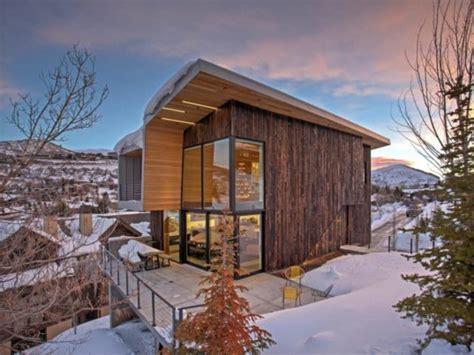axis architects designs stunning mountain passive house  utah  burnt cedar cladding