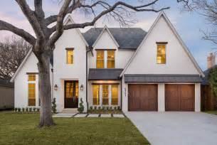 white house with black trim cjb homes