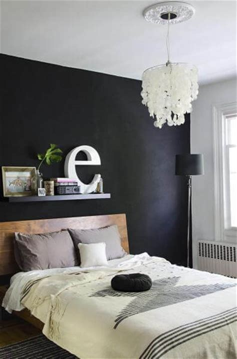black paint for bedroom walls paint a black wall in the bedroom