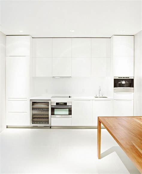 All White Kitchen Cabinets Modern House Plan With Clean Lines Open Design By Grzywinski Pons