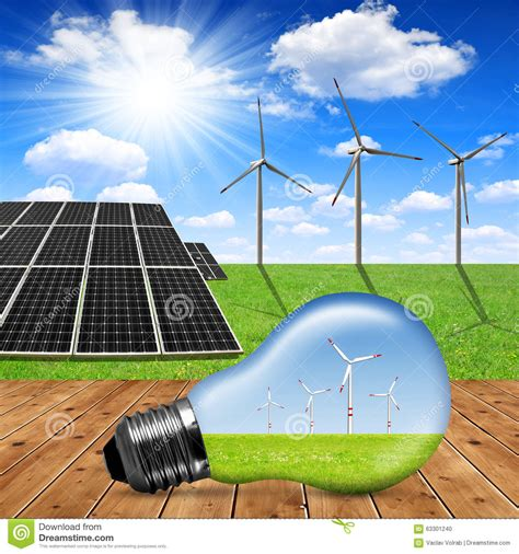 eco light bulb in the background solar panels and wind