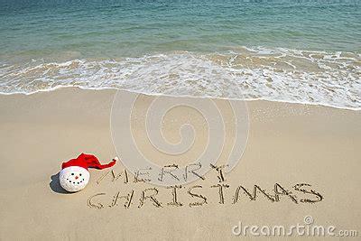 merry christmas written  tropical beach white sand  snowman royalty  stock photo
