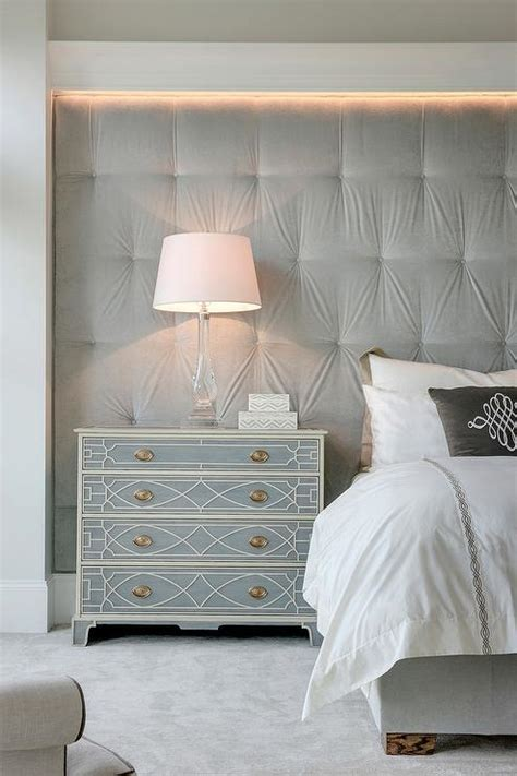 decorating bedroom walls with fabric gray velvet tufted fabric lined wall as headboard