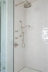 white shower shower with white subway tiles and glass shower partition
