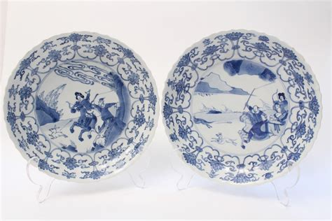 a near pair of blue and white hunt dishes kangxi period 1662 1722 littleton hennessy