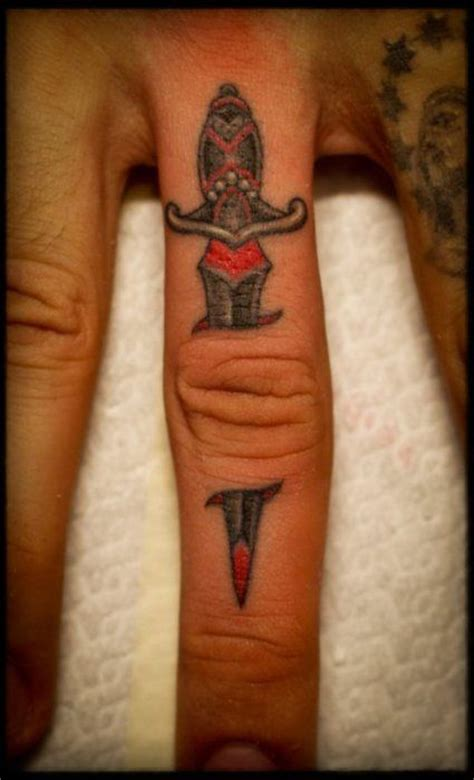 finger tattoo cover up ideas jeweled dagger finger tattoo love it rat a tat tat
