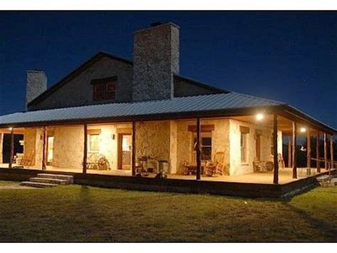 ranch house plans with wrap around porch ranch house plans lodge rental bar none ranch wrap around porch lit up at