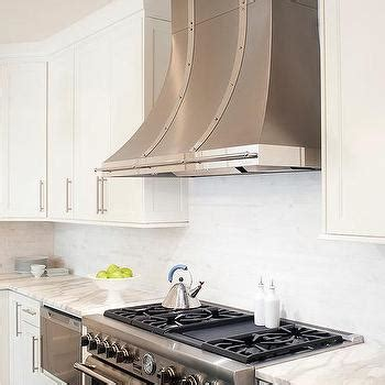 small white kitchen with steel hood white french kitchen hood with stainless steel trim