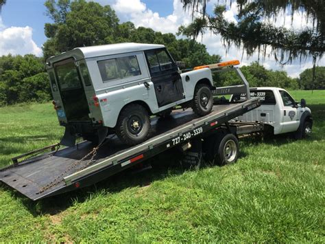 flatbed truck bed car stuck and need a flat bed towing truck near me allways
