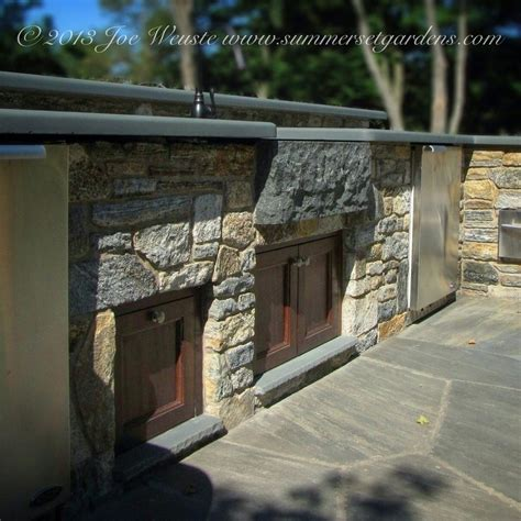 a simple outdoor kitchen that matches the indoor kitchen outdoor kitchen design ideas patio traditional with custom