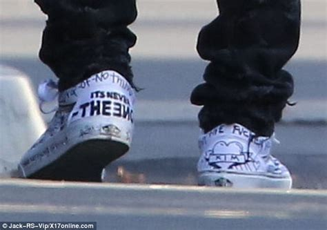 Offwhite I M His Sneaker Cde kanye west steps out in graffiti sneakers as he grabs