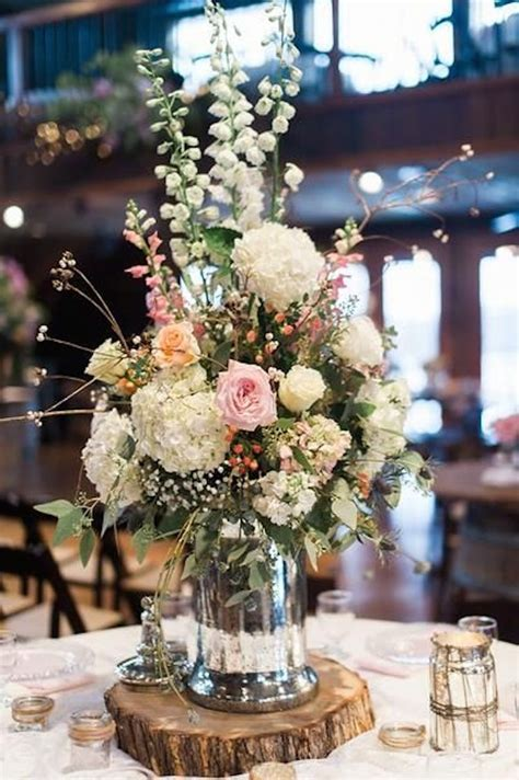 Gorgeous Floral Centerpiece On A Rustic Wood Slab Onewed Com Rustic Wood Centerpiece