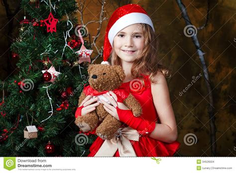 cute  girl   christmas tree stock images image