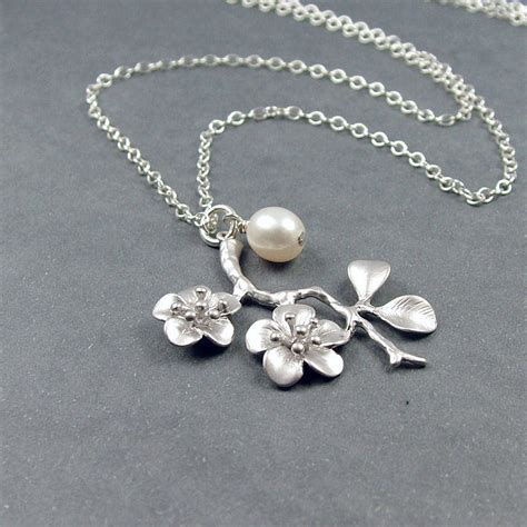 silver cherry blossom and pearl necklace by wished for