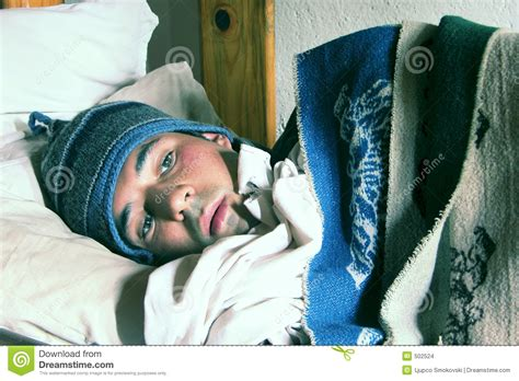 cold bed young man in a bed feeling cold stock photo image of