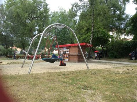 park swings for adults adults on a swing in park near promenade picture of