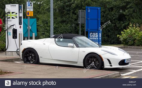 Tesla Car Company Stock Tesla Roadster Electric Car Supercar On Charge At Heston
