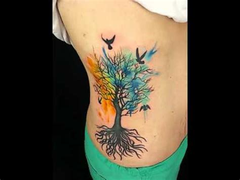 custom watercolor style side piece tattoo of tree and