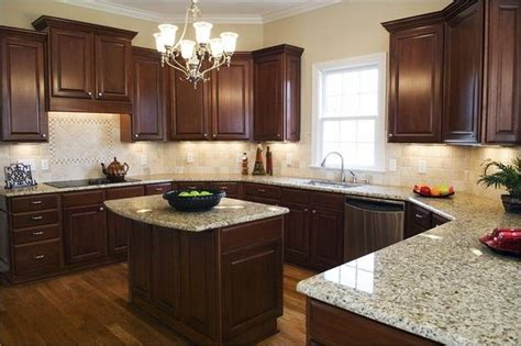 light kitchen countertops dark floors dark cabinets light granite counter tops