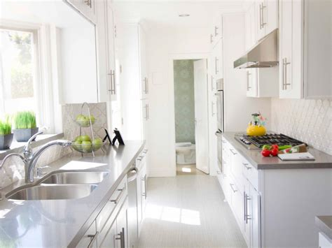 light gray kitchen cabinets with white countertops white galley kitchen design with glossy light grey quartz