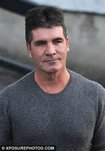simon cowell appears fuller faced   appears   tonight show  jay leno daily mail