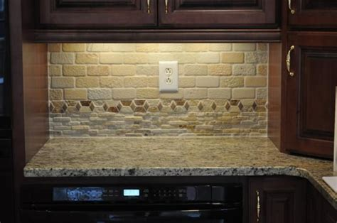 tumbled backsplash and new venetian gold granite