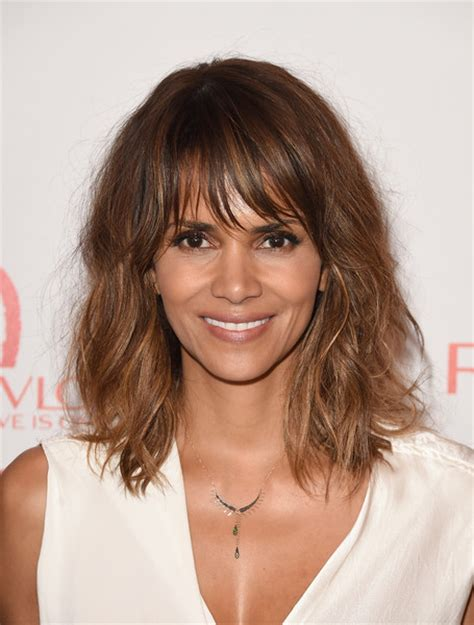 50s hairstyle research halle berry medium wavy cut with bangs hair lookbook