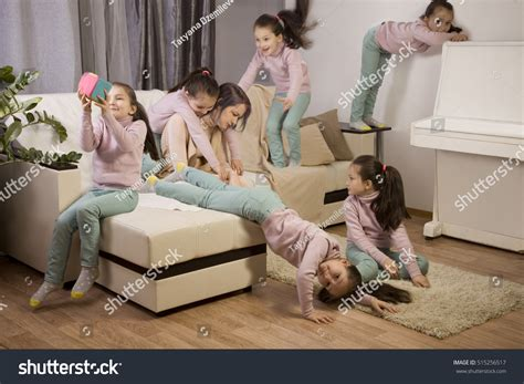 little girl behind the couch song tired mother kids girl jumping on stock photo 515256517