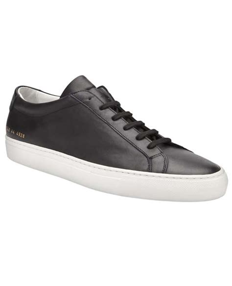 black sneakers white sole common projects original achilles leather low top sneakers