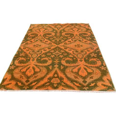 orange ikat rug ikat and suzani design