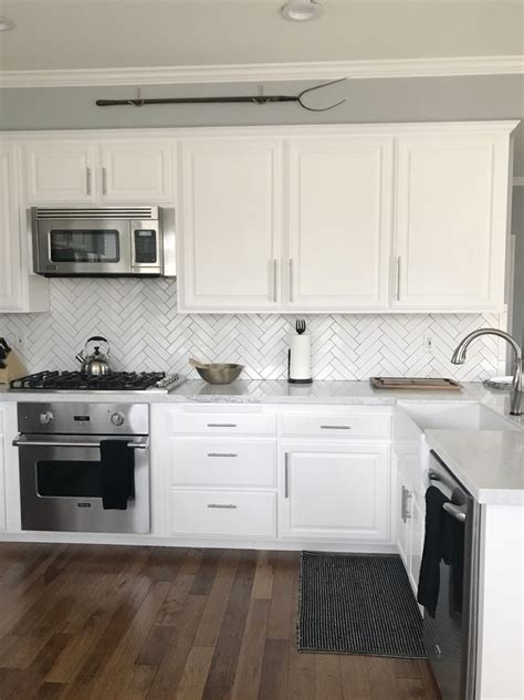 white cabinets  white carrera marble farm house sink