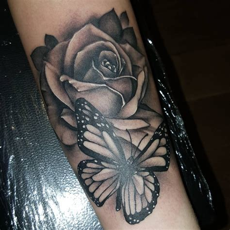rose tattoo with butterfly 43 beautiful forearm tattoos
