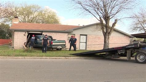 truck crashes truck crashes into house on side