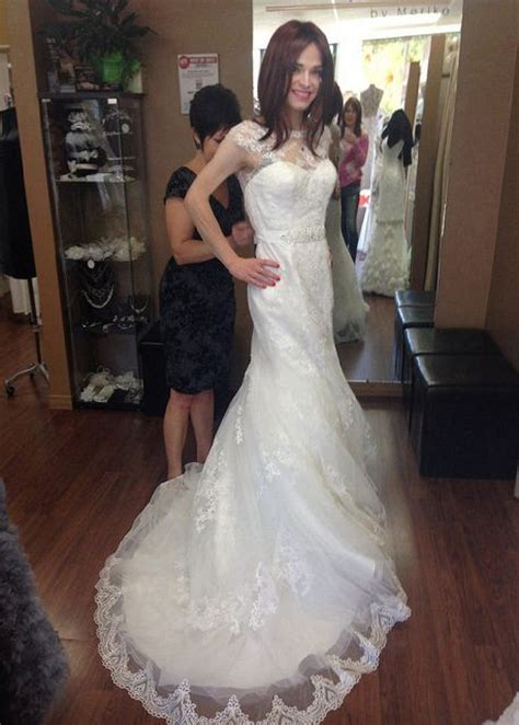 Wearing A Wedding Gown by Beautiful Bridal Crossdresser Is Being Fitted For
