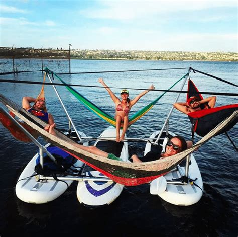this floating hammock is your new favorite lake accessory