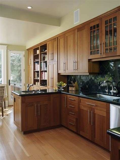 oak cabinets with black countertops for the home