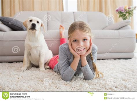 in rug and home commercial pin in the corner with puppy on