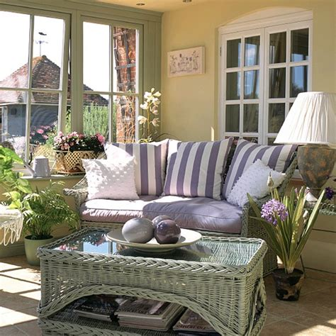 conservatory living room conservatory with wicker furniture and plants housetohome co uk