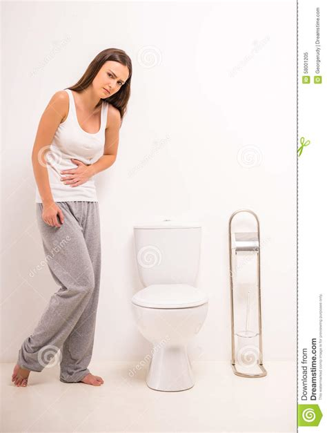 Woman In Toilet Stock Photo   Image: 58001205