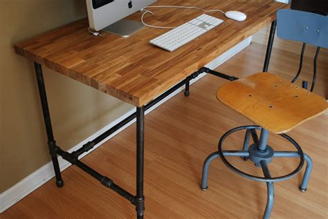 industrial desk with oak top and steel pipe legs