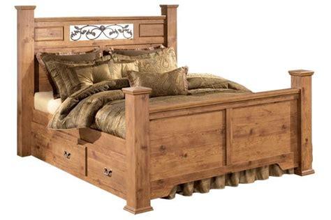 sleigh bedroom set with underbed storage in pine grain bittersweet queen poster bed with underbed storage in pine