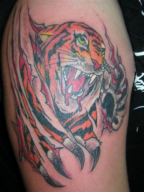 dragon tattoo ripping through skin ripped skin dallas cowboys team logo tattoo ideas in