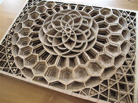 Laser Cut exquisite geometric artworks from layers of laser cut plywood