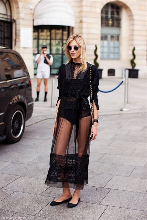 paris through a fashion street style anja rubik wears a risqu 233 sheer dress the front row view