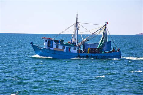 on a boat at sea shrimp boat at sea 1017 photograph by larry roberson