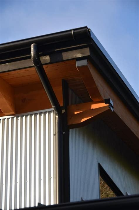 living in the gutter with black half gutter with galvanized siding