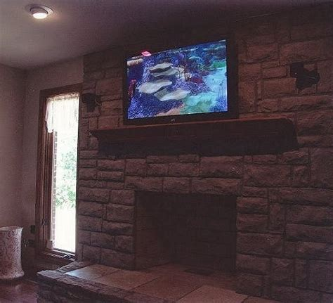 Flat Screen Tv Above Fireplace by Flat Panel Tv Above Bricked Fireplace Living Room