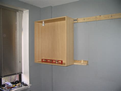 how to hang cabinets hanging the cabinets