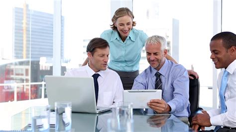 south american using laptop stock photos south american using laptop stock images alamy group of business people using laptop and tablet computer by wavebreakmedia